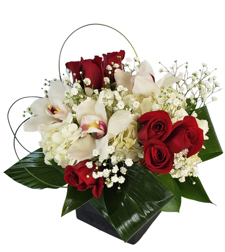 Small Flower Arrangement with Hydrangeas, Red Roses and Orchids